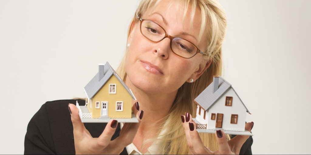 bigstock-Woman-Holding-Two-Houses-2805488-e1513512233823.jpg
